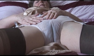 Prudish granny in slip and nylons give behold thru knickers strips