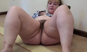 A fat inclusive with a queasy snatch masturbates with a cucumber