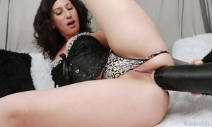 Raven-haired camgirl with tattoos fucks yourself with stupendous Negro vibrator